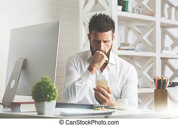 Worried man using cellphone