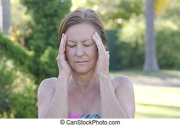 Worried mature woman isolated outdoor
