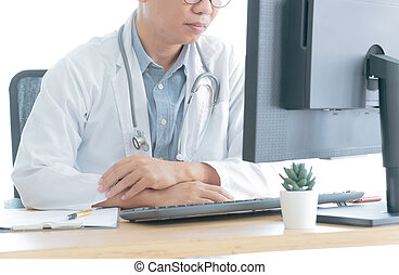Worried men doctor using computer at office