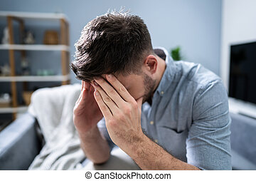 Man Suffering From Headache At Home
