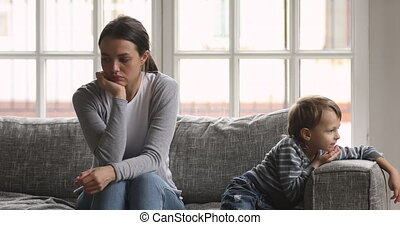 Worried millennial mother babysitter ignoring bored small ...