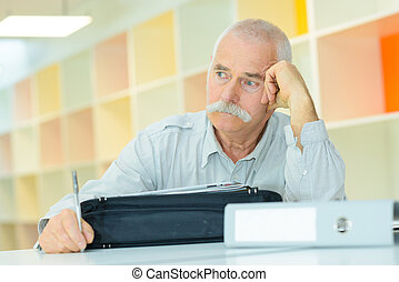 worried office worker analyzing his career path