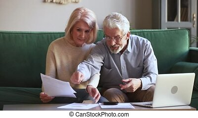 Worried old couple stressed about unpaid bank debt holding...