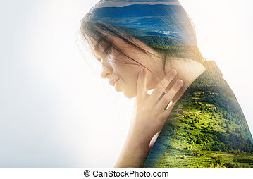 Worried person touching her neck while having a pain in it