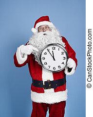 Worried santa claus holding clock