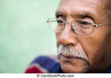 Worried senior african american man with eyeglasses - Senior...