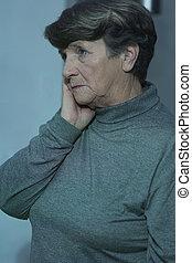 Worried senior woman having problems