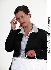 Worried woman carrying  a briefcase