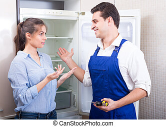 woman complaining to handyman