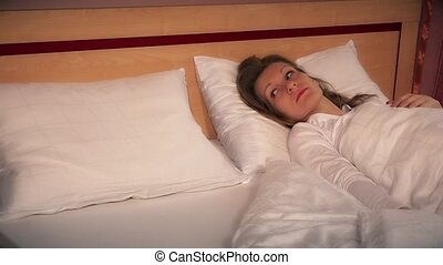 worried woman female wake up lonely in bed after divorce....