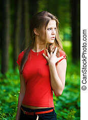 Worried woman in a forest
