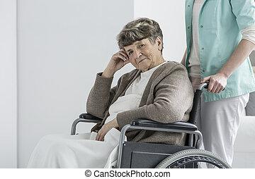 Worried woman in wheelchair