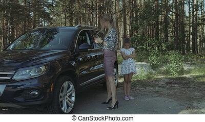 Worried woman near broken car calling for help - Desperate...