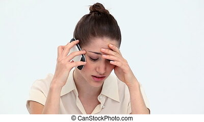 Worried woman phoning with a mobile phone