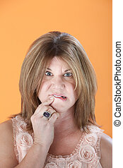 Worried Woman - Worried middle-aged Caucasian woman on...
