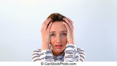 Beautiful worried woman standing against white background 4k