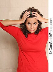 Worried woman - A worried woman holding her head.