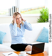 worried woman stressed with laptop