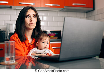 Worried Woman Working a Laptop Holding Her Baby