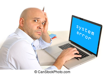 worried young business man technical problem at computer -...