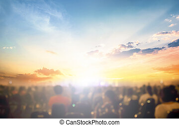 Worship concept: church praise at sunset background