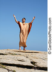Worship - Man with arms raised to the sky in worship
