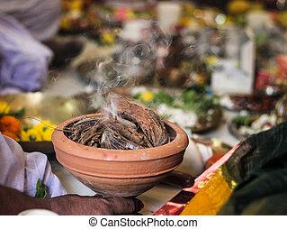 worship of indian god godess idol dhoop dhuno dhunichi durga puja with narkel chobra