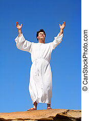 Worship praise happiness - A man raises his arms heavenward...