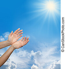 Worshiping the Divine Source - Female hands reaching up ...
