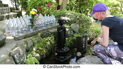 Worshipping at Jizo Statue