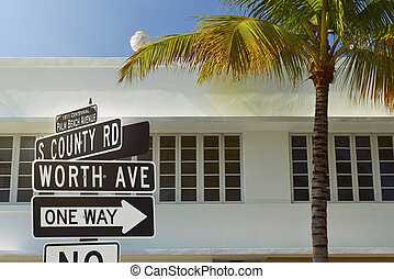 Palm Beach - Worth Avenue street sign with palm tree and art...