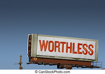 Close up on a billboard sign with WORTHLESS text