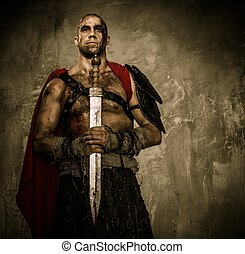 Wounded gladiator holding sword covered in blood with both hands
