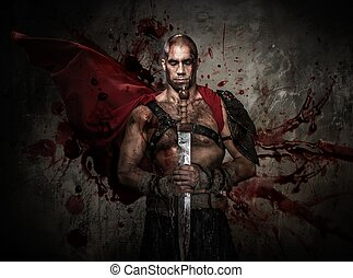 Wounded gladiator holding sword covered in blood with both...
