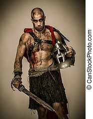 Wounded gladiator with sword covered in blood and helmet isolated