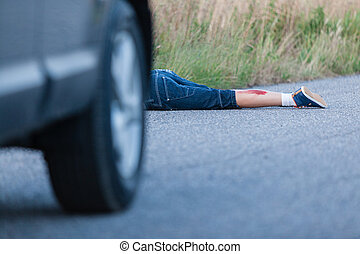 Wounded Legs of a Boy Hit by Car Lying on the Road - Wounded...