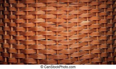 Woven Basket Rotating - Closeup of woven basket turning...