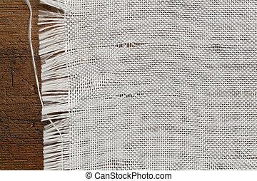 woven fiberglass cloth - edge of woven fiberglass cloth on a...