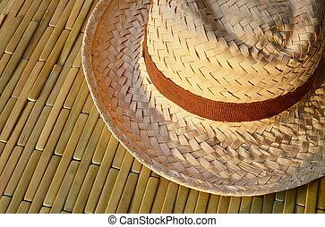 woven hat on bamboo floor