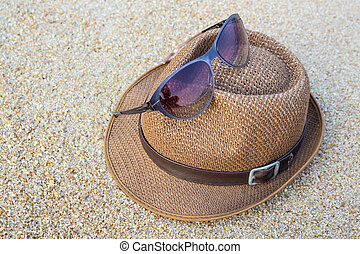 Woven hat with sunglasses. - Woven hat with sunglasses on...