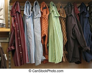 Woven Shirts - Shot of a few woven shirts hanging on the...