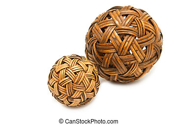 Woven wickerwork ball made from bamboo on white background