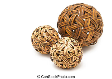 Woven wickerwork balls made from bamboo on white background