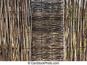 woven wooden fence of twigs of hardwood