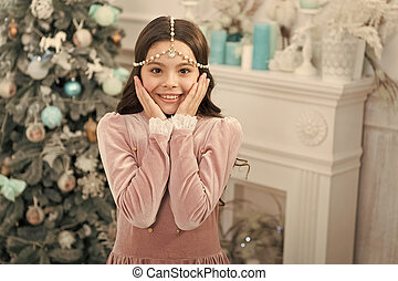 wow. holiday party celebration. christmas home decoration. xmas shopping time. awaiting new year. pretty little princess celebrate christmas. smiling cute child at home. happy new 2020 year