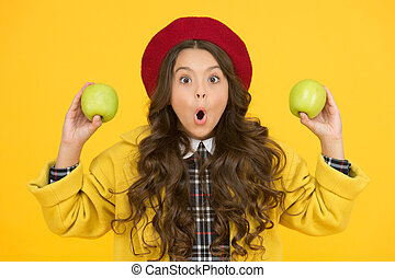 Wow its organic. Surprised little girl yellow background. Small child hold organic apples. Eating natural organic food. Organic decision. School health