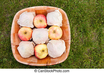 Wrapped apples in a bowl