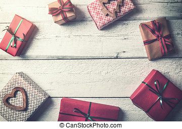 wrapped christmas gifts on wooden background with copy space. flat lay