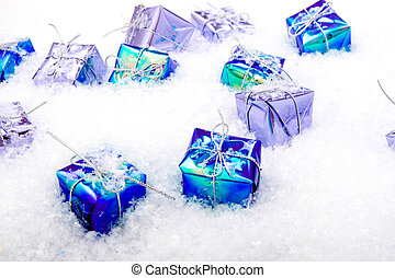 wrapped gift boxes in snow