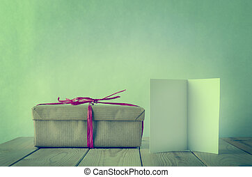 Wrapped Gift in Brown Paper with Blank Card